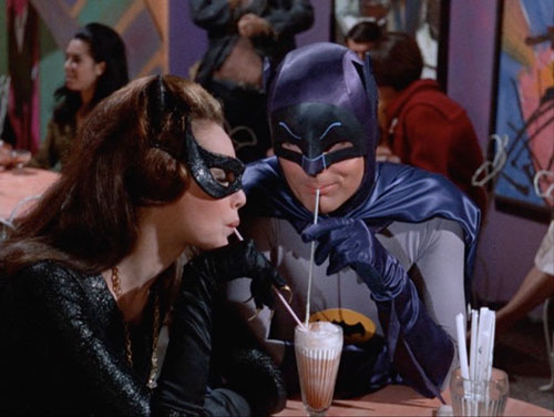 Batman and Catwoman in soda shop