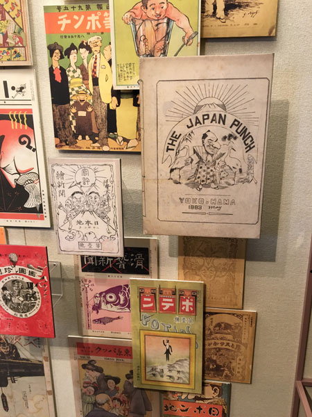 "A display of early ""caricature"" magazines"